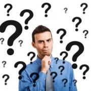Businessman question marks