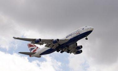 42698081 - boeing 747 jet preparing to land wheels down on final approach