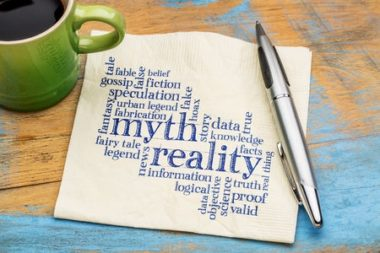 57997743 - myth versus reality word cloud - handwriting on a napkin with cup of coffee