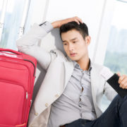 frustrated traveler with luggage