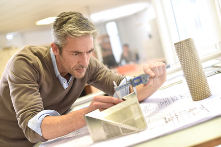 industrial designer working on project in office