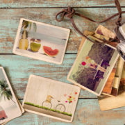 photo album of trip in summer on wood table. instant photo of retro camera - vintage and retro style