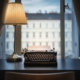 An old typewriter and a lamp on the table.